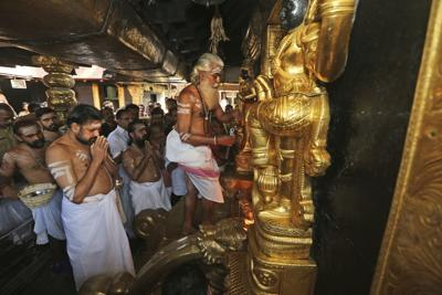 The head priest opens the sanctum sanctorum of the Sabarimala temple, one of the world's largest Hindu pilgrimage sites, in Kerala state, India. India's Supreme Court will set law on women's entry into temples and mosques after being asked to review its decision lifting a ban on some women entering the Sabarimala temple in Kerala state. — AP Photo/Manish Swarup, File