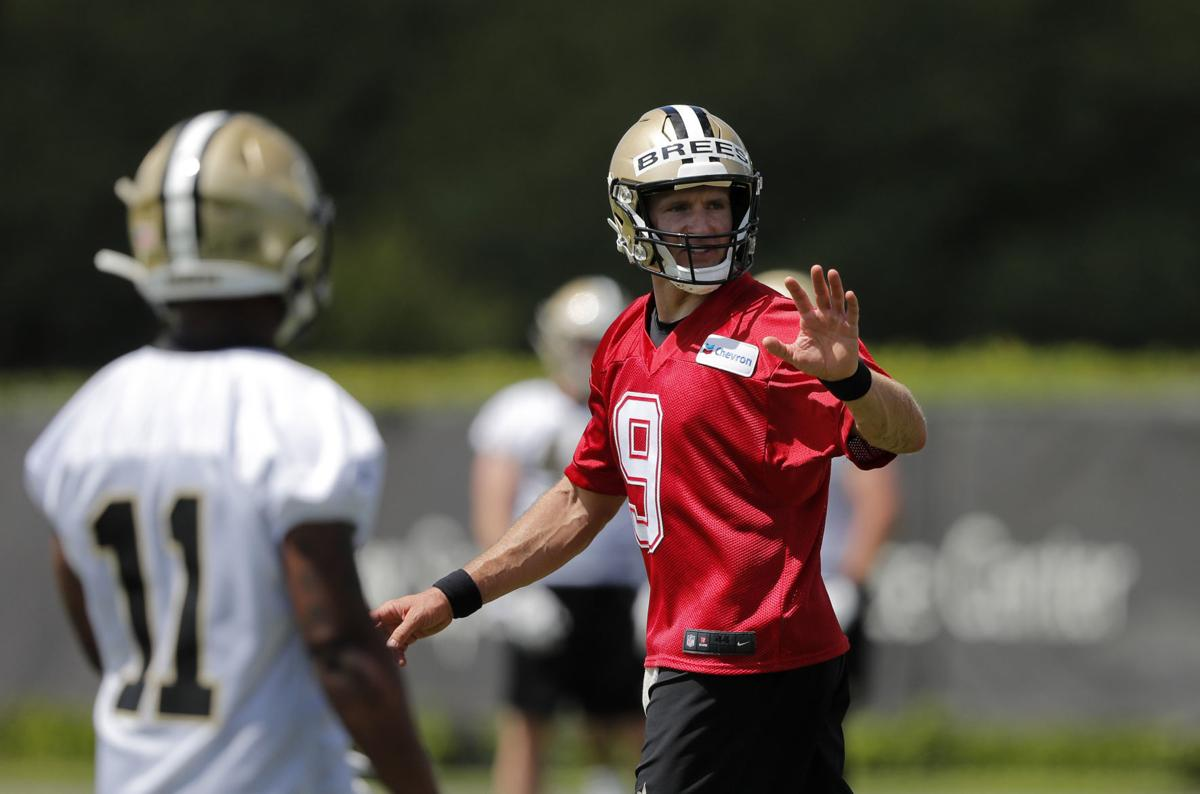 New Orleans Saints quarterback Drew Brees (9) works out with rookie wide receiver Deonte Harris during  football practice in Metairie, Louisiana. — AP Photo/Gerald Herbert