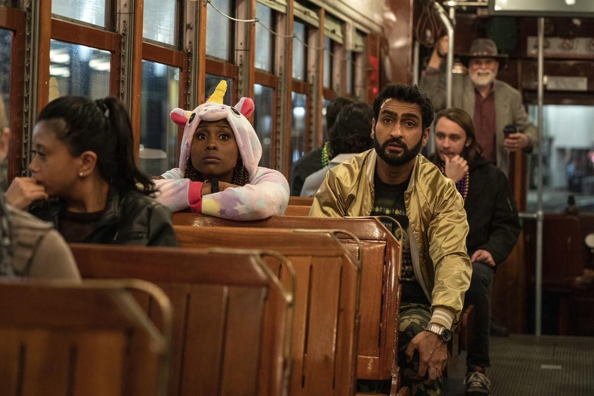 "Issa Rae as Leilani, Kumail Nanjiana as Jibran of ""The Lovebirds."""