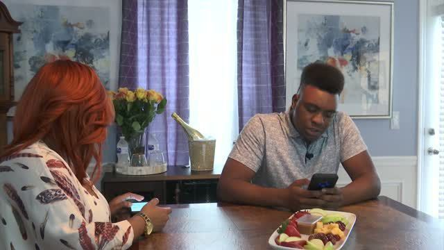Demetrius Howard, with the help of his mother, Tamika Grahm, other supporters, will award an African American male student, who has lost their father to gun violence, with $1,000, a computer, and a printer.— AP PHOTO
