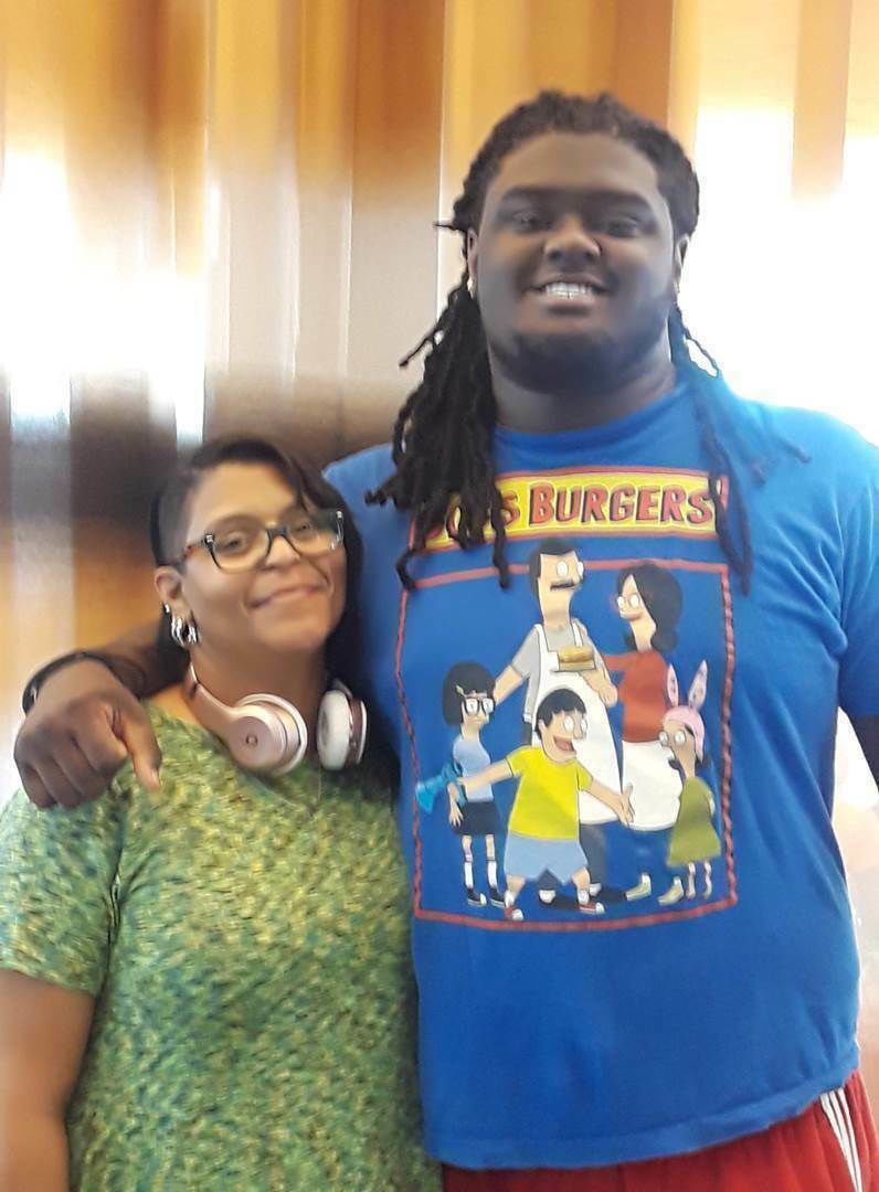 In this undated photo provided by Joanne Atkins-Ingram, is of her and her son Braeden Bradforth. Newly released emails show the chaotic details surrounding the heatstroke death of Braeden Bradforth, a New Jersey football player after the first day of practice last year at Garden City Community College in Kansas. The emails obtained by The Associated Press through an open records request show the assistant coach who arrived at the scene determined Bradforth was in visible distress, but instead called the head coach and athletic trainer rather than 911. - Courtesy Joanne Atkins-Ingram via AP