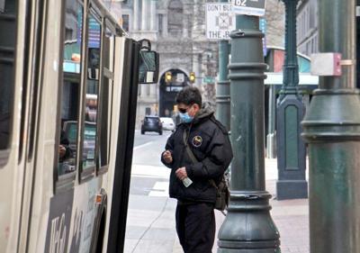 A passenger boards a SEPTA bus on Market Street near City Hall. (Emma Lee/WHYY)