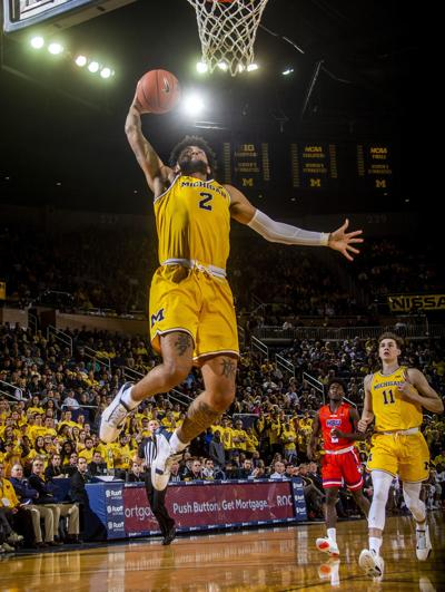 Michigan forward Isaiah Livers (2) dunks during the second half of the team's college basketball game against Houston Baptist in Ann Arbor, Mich. on Nov. 22. Michigan won 111-68. — AP Photo/Tony Ding