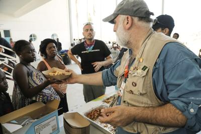 This Sept. 6 photo released by Amilcar Navarro shows chef Jose Andres distributing food at the Marsh Harbour Government Complex in Abaco, Bahamas, in the wake of Hurricane Dorian. Andres, who has two James Beard Awards and nearly three dozen restaurants, founded the nonprofit World Central Kitchen in 2010 to respond quickly with food and water distribution after natural disasters and other emergencies around the globe. — Amilcar Navarro via AP