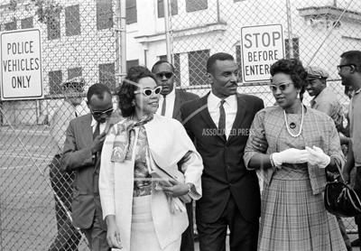 In this April 18, 1963 file photo, Coretta Scott King Jr., left, the Rev. Fred L. Shuttlesworth, center, and Mrs. Juanita Abernathy, leave Birmingham jail after visiting the Rev. Martin Luther King, Jr. and the Rev. Dr. Ralph Abernathy in Birmingham, Alabama. Juanita Abernathy, who wrote the business plan for the 1955 Montgomery Bus Boycott and took other influential steps in helping to build the American civil rights movement, has died. She was 88. Family spokesman James Peterson confirmed Abernathy died on Thursday, Sept. 12, 2019 at Piedmont Hospital in Atlanta following complications from a stroke.— AP Photo/File