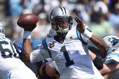 Carolina Panthers quarterback Cam Newton (1) looks to pass against the Los Angeles Rams during the first half Sunday's NFL game in Charlotte, North Carolina. — AP Photo/Mike McCarn