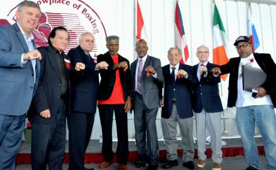From left to right, International Boxing Hall of Fame Class of 2019 inductees : Teddy Atlas, Don Elbaum, Lee Samuels, a former sports writer at The Philadelphia Bulletin, Julian Jackson, Donald Curry, Tony DeMarco, Guy Jutras and Buddy McGirt display their IBHOF rings during the induction ceremony on Sunday in Canastota, New York. —  John Brewer/Oneida Dispatch via AP