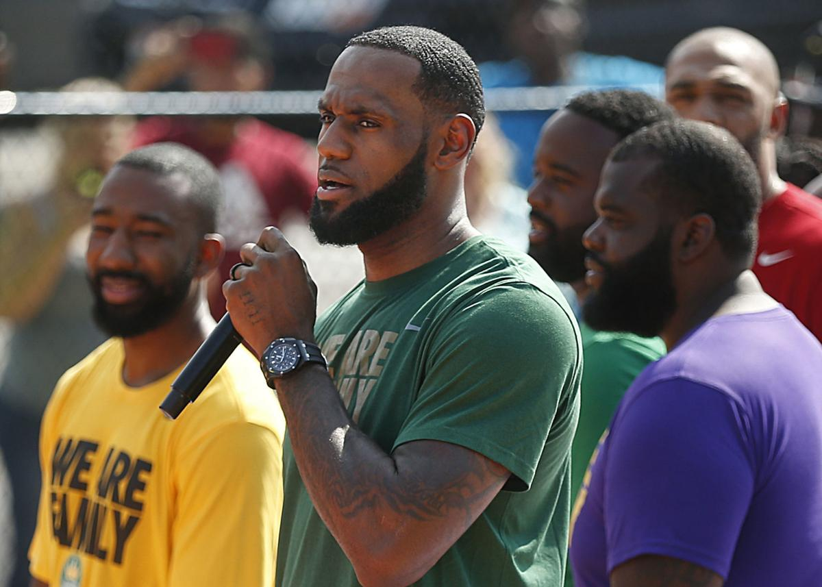 LeBron James speaks during the debut of the new basketball court at I Promise School on Wednesday in Akron, Ohio. The NBA superstar is spending more than $1 million on various upgrades for the school. — Jeff Lange/Akron Beacon Journal via AP