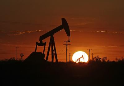 Energy stocks swing with economic signals, Mideast tensions