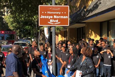 Students at the Jessye Norman School of the Arts unveil a sign naming the street outside the school in honor of the late opera star on Friday in Augusta, Georgia. Norman, who won five Grammy awards including a lifetime achievement honor in her distinguished career, died on Monday, Sept. 30, 2019. She was 74. Her funeral is slated for Saturday and a benefit concert for the school follows on Sunday. —  AP Photo/Jeffrey Collins