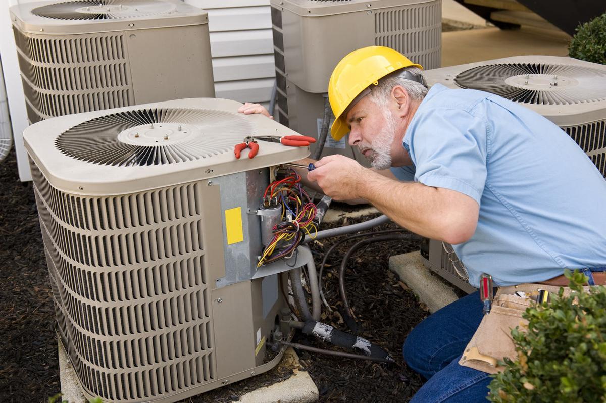 Mature Repairman Works On Apartment Air Conditioning Unit