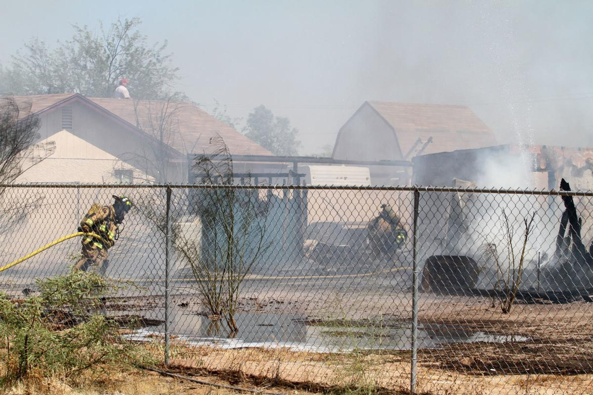 House fire causes brush fire