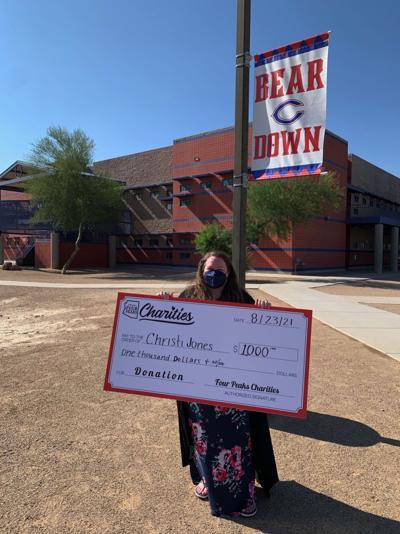 High School teacher receives $1,000 award for school supplies
