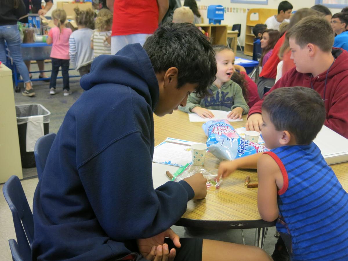 Preschool and Junior High make Truffula Trees