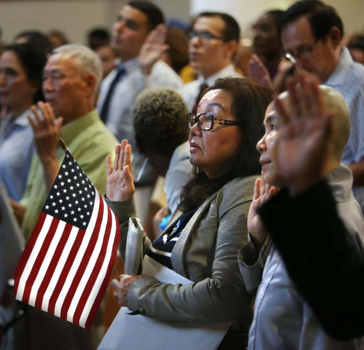 250 people become new citizens in CGMS auditorium