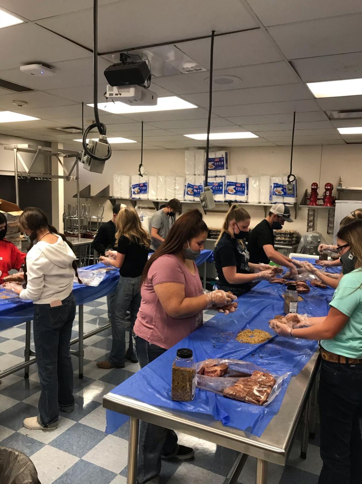 Students prep steaks for CG steak fry