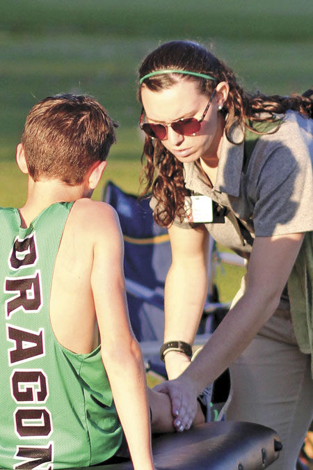 Huberty honored for helping Dragon athletes