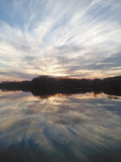 Sky spirals above still waters of Cross Lake