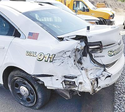 Driver crashes into squad car on Main Street