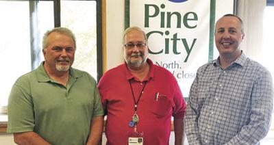 Pine City Fire Marshal Dave Hill passes the torch