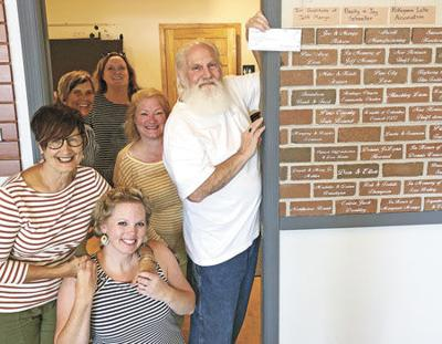 Pokegama Lake Association gives Pine Center for the Arts another brick in the wall