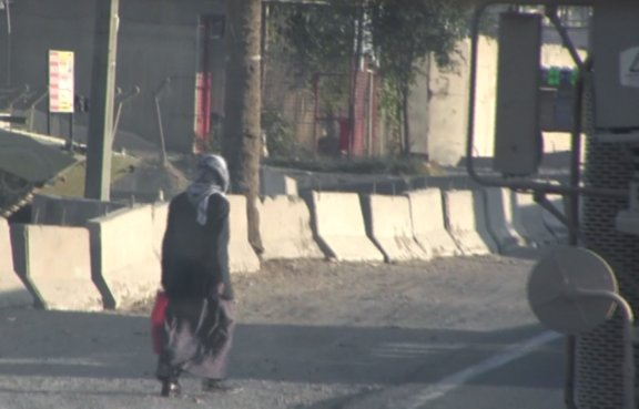 A Baghdad pedestrian tromps along the roadway