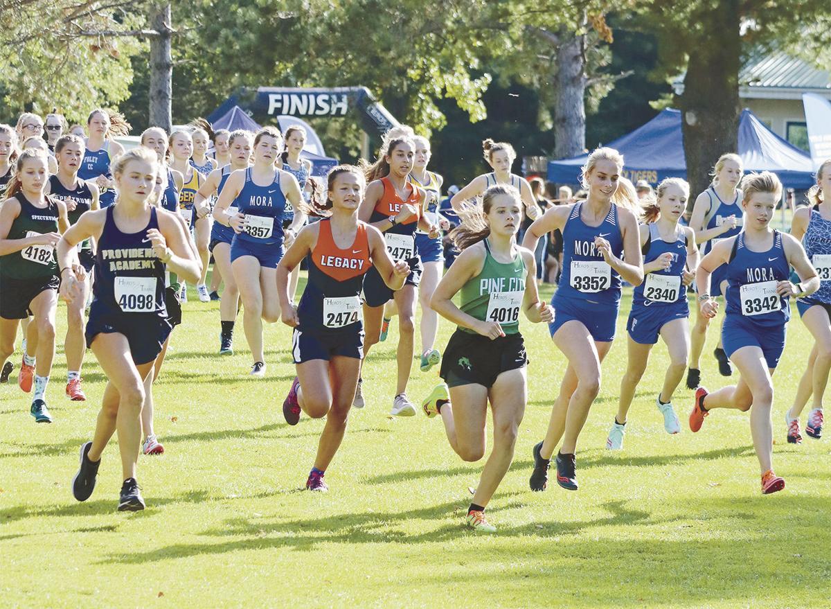 Cross-country team races through Mora