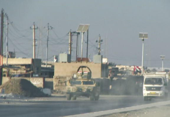 An Iraqi armored vehicle rolls through