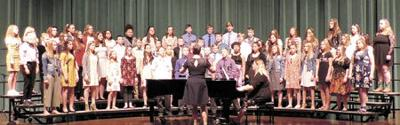 Eighth grade choir lift voices for Pine City