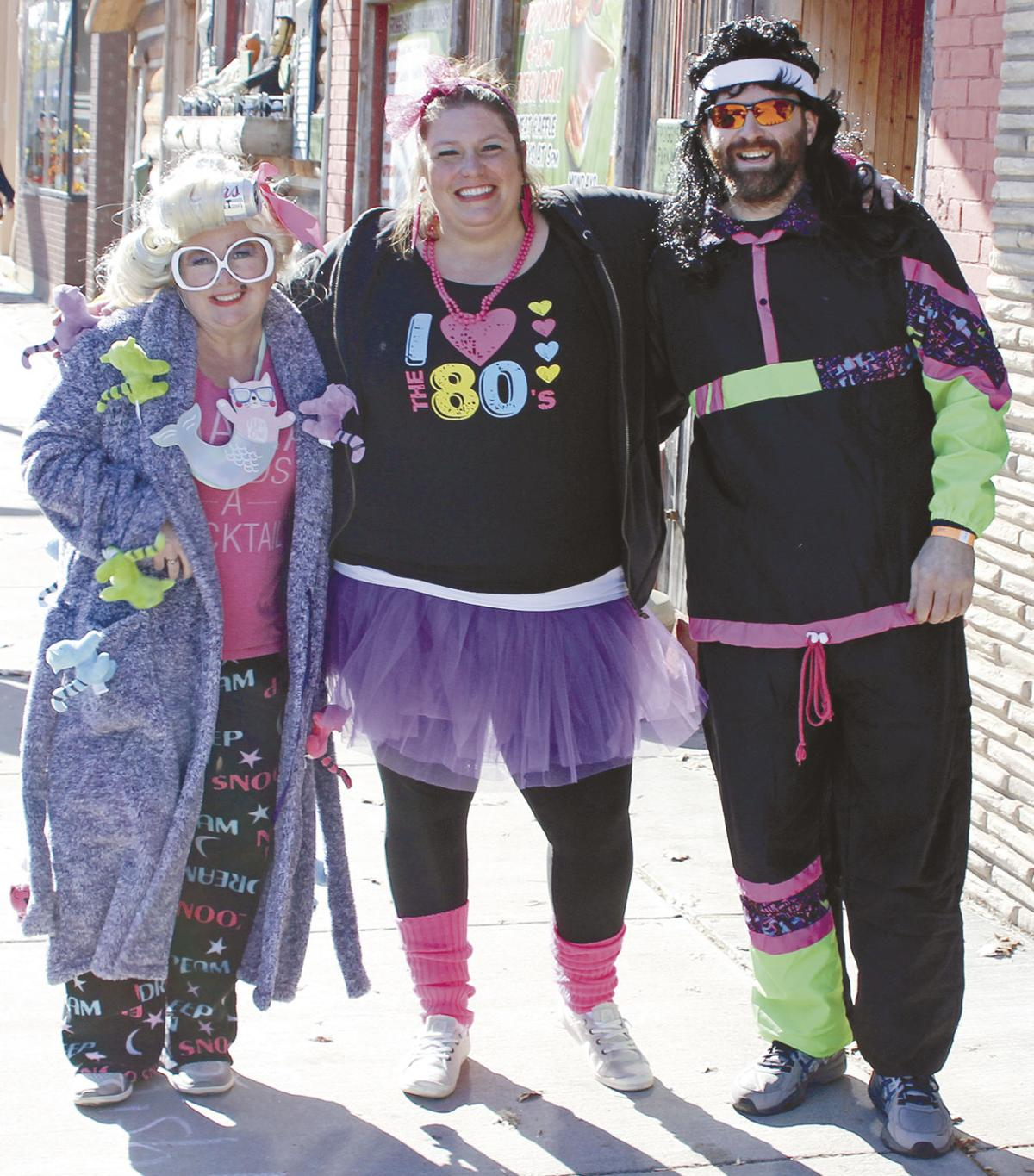 Colorful characters charge down 5th Street