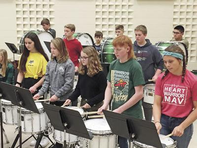 Junior High drummers  get into the beat