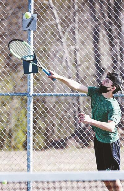 Boys tennis overcomes cold, competition