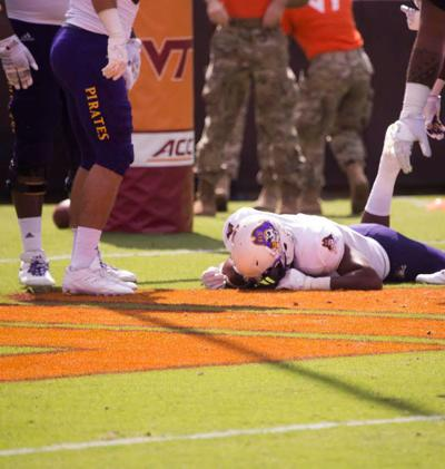 James Summers lying face down at Virginia Tech game.