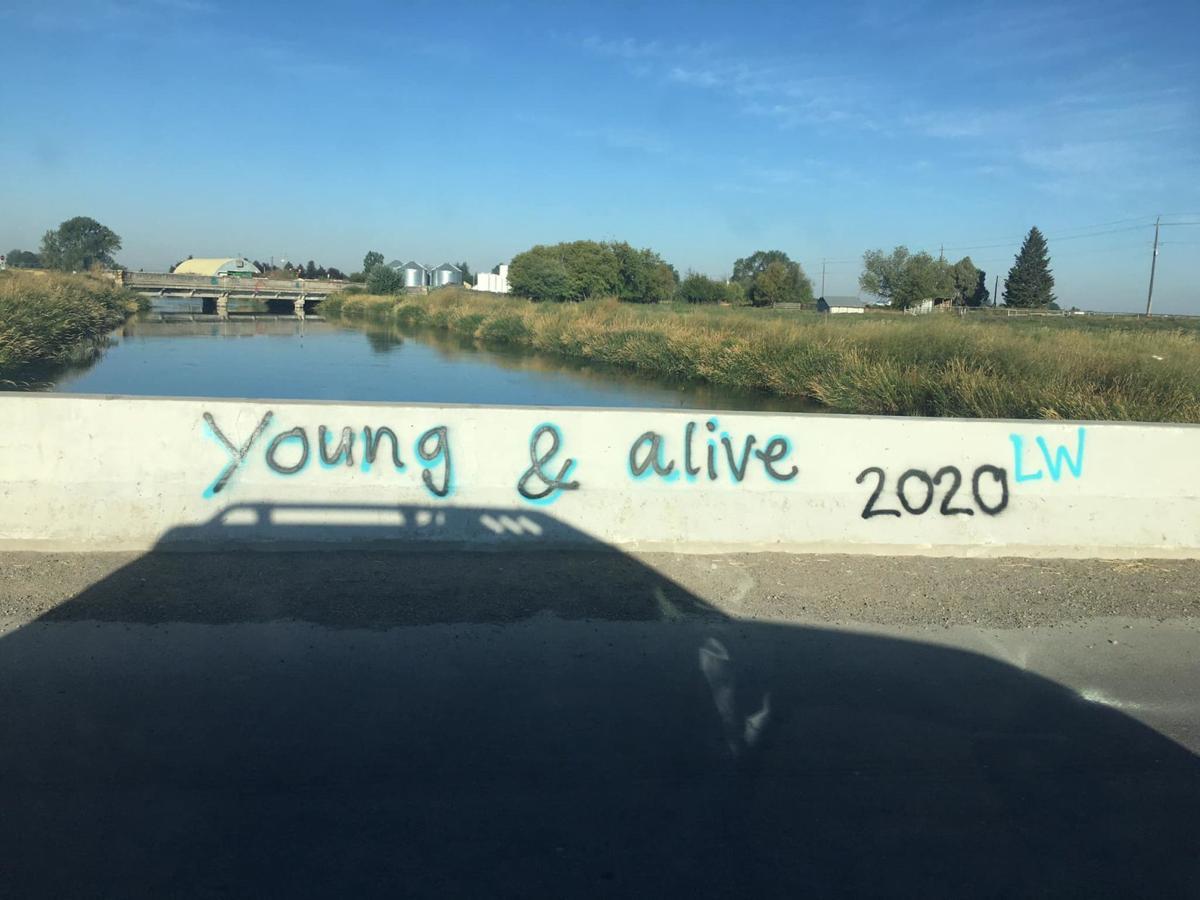 Graffiti on one side of the bridge