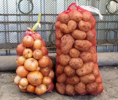 a sack of potatoes and onions