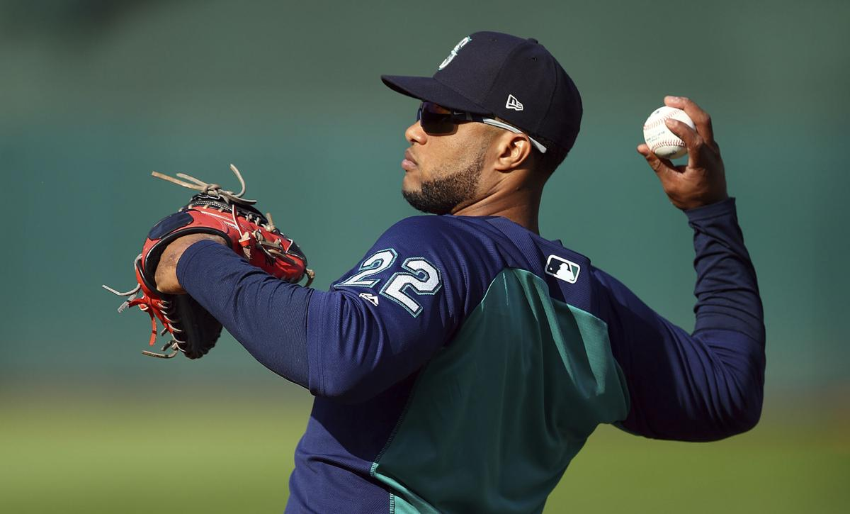 Mariners' Cano returns from drug suspension, now playing 1B