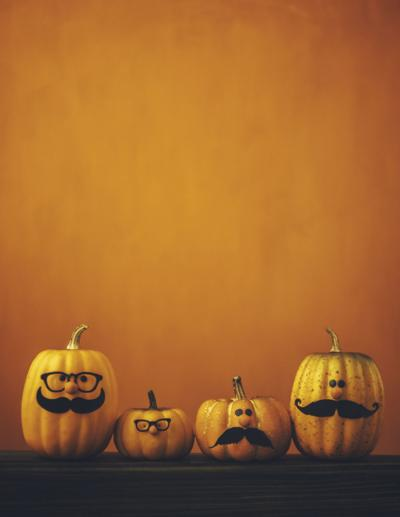 Cute pumpkin halloween characters on bright orange background