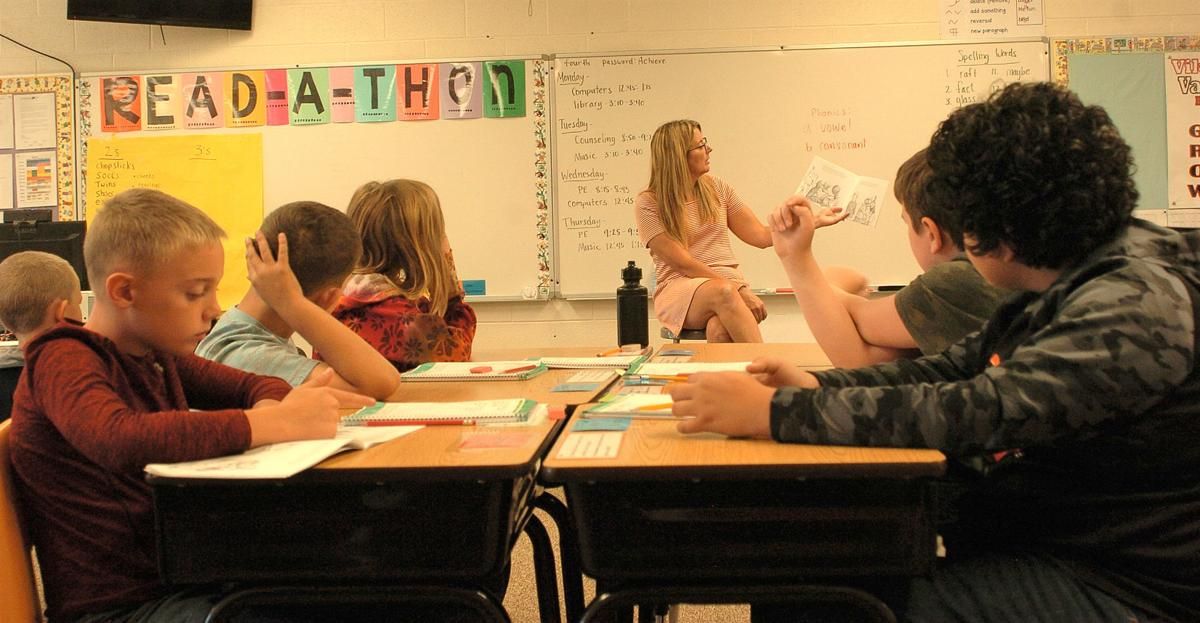 school teacher reading 9.4.19.jpg