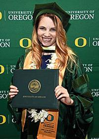 Lewis earns doctoral degree