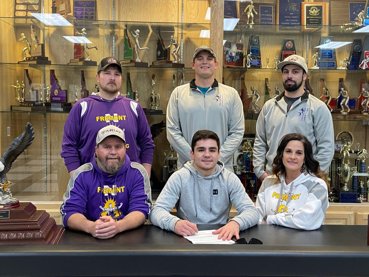 North Fremont's Riggen Cordingley posses for a photo after signing his letter of intent to wrestle at Western Wyoming Community College.