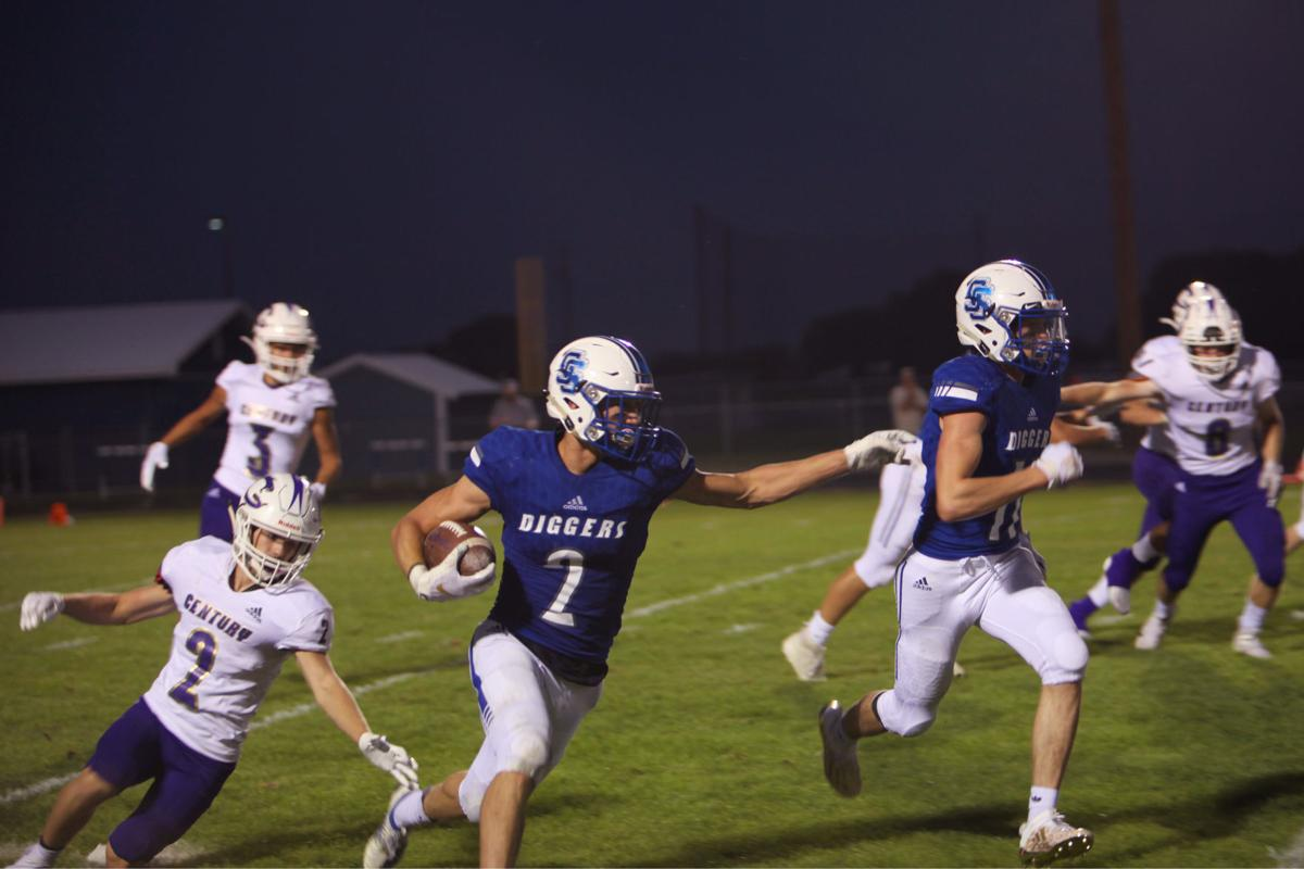 Sugar-Salem's Brigham Lee(2) directs his blockers as he returns a kickoff against Century in Sugar-Salem's 13-7 win Friday.