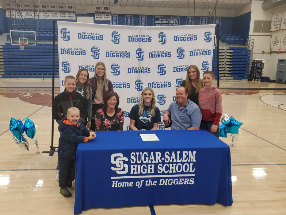 Mardee Fillmore poses for a photo with her family after signing her letter of intent.
