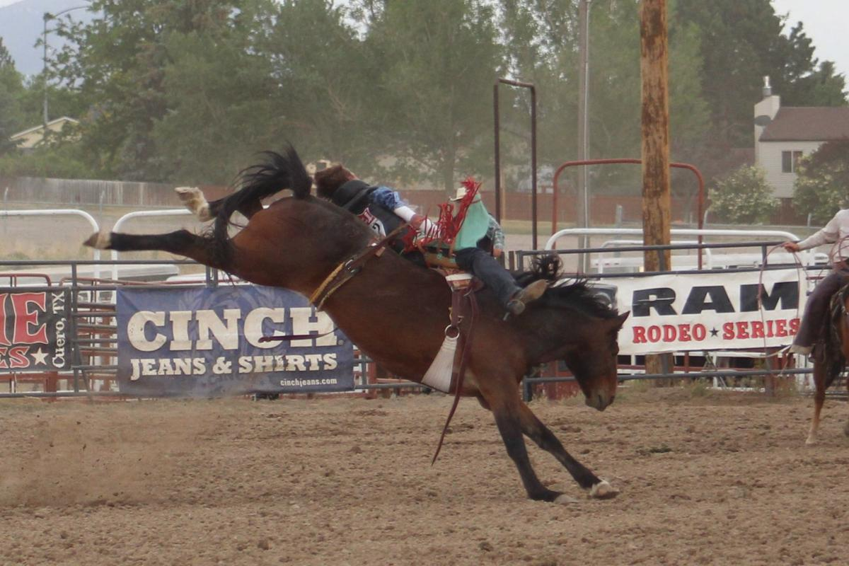 State rodeo reaches halfway point, bareback second go-round final