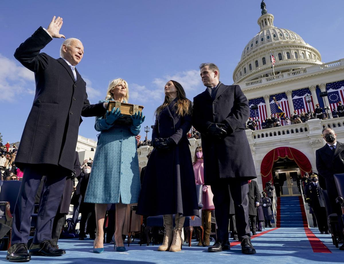 'Democracy has prevailed': Biden takes the helm as president
