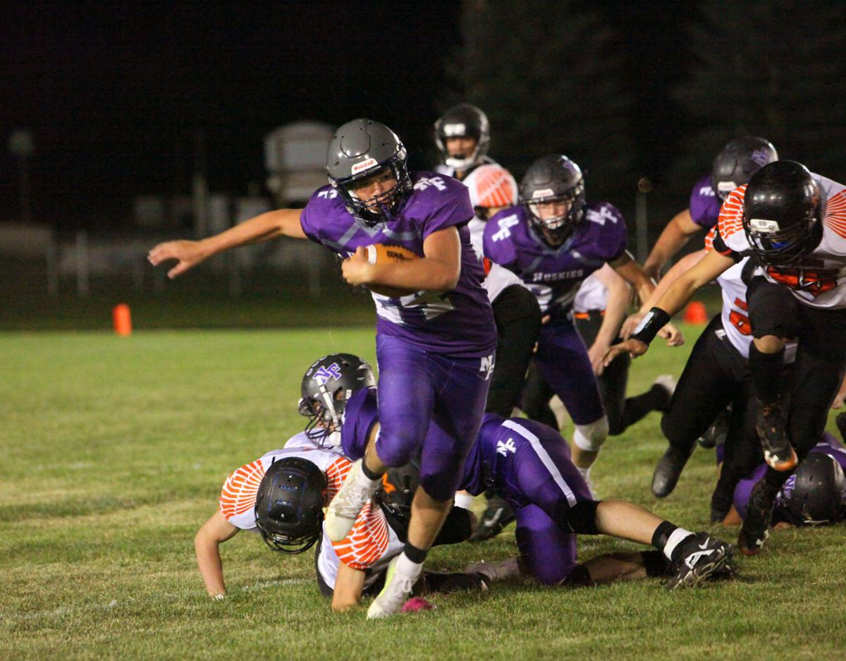 AJ Hill slips away from a Malad defender.