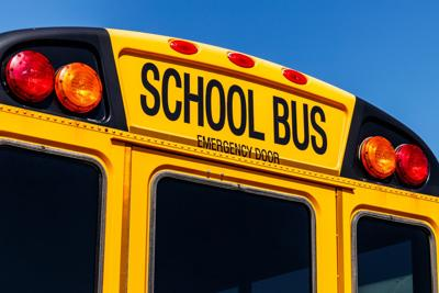 Yellow School Bus in a District Lot Waiting to Depart for Students VI