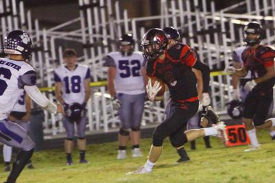 South Fremont's Forbush heads up the sideline after catching a Kaimen Peebles pass.
