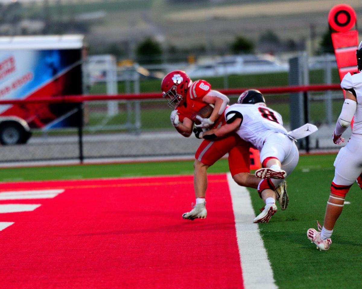 Madison running back Ben Dredge gets across the goal line.