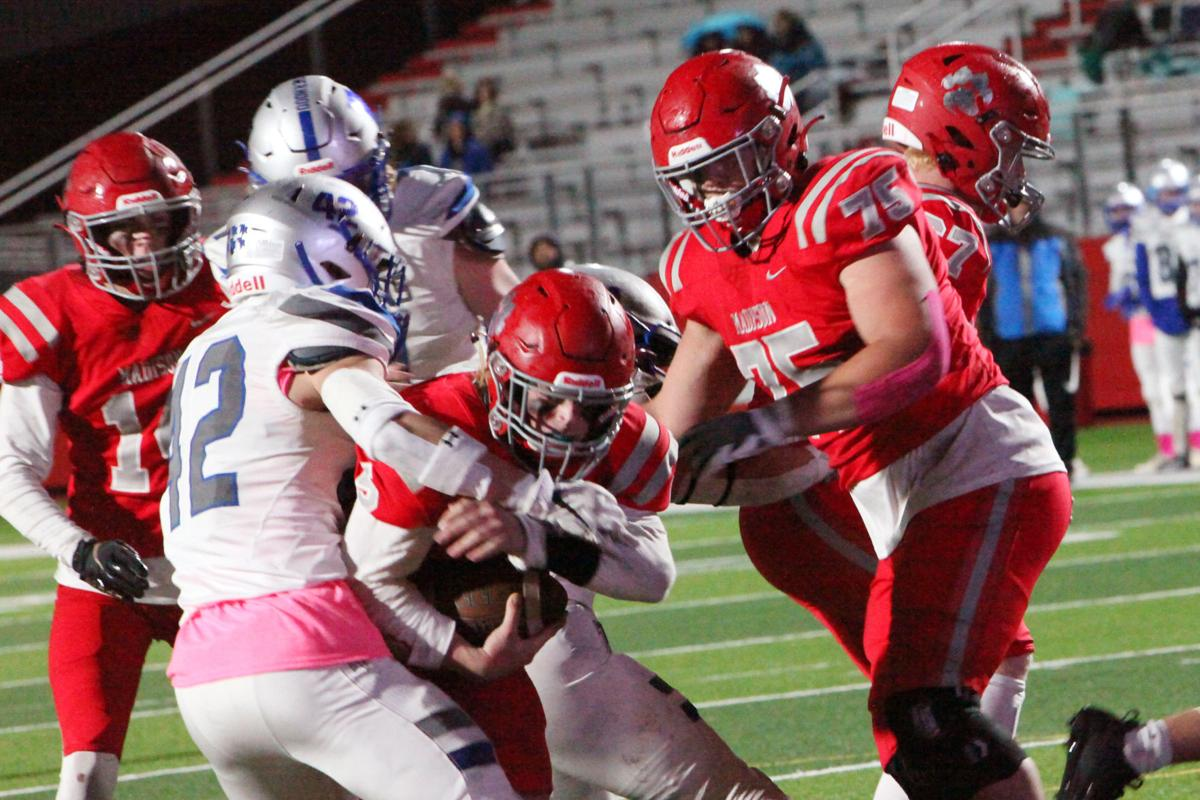 Madison quarterback Ben Dredge pushes through the Thunder Ridge defense to score the first of his two overtime touchdowns.