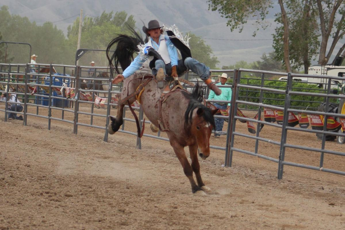 Saddle bronc riding close, only three have ridden